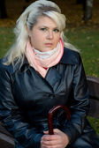 Young woman in a leather coat — Stock Photo