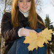 Young girl in autumn park — Stock Photo