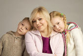 Smiling mother with her childen — Stock Photo