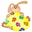 Easter bunny with a painted egg - Stock Vector