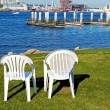 Stock Photo: Chairs by the Ocean