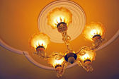 Home interiors Chandelier on ceiling — Stock Photo