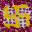 Постер, плакат: Rose petals swastika rangoli decoration
