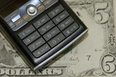Mobile phone in dollars — Stock Photo