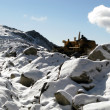 Stock Photo: Bulldozer clearing Snow