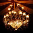 Home interiors Chandelier on ceiling - Stock Photo