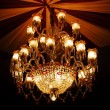 Stock Photo: Home interiors Chandelier on ceiling