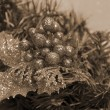 Christmas Decoration Balls and Leaves sepia — Stock Photo