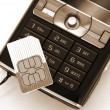 Cellphone sim card sepia — Stock Photo #1458492