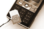 Cellphone sim card sepia — Stock Photo