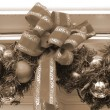 Christmas Decoration Balls and Ribbon sepia — Stock Photo