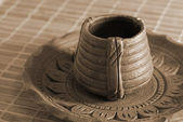 Earthen Pottery Tea Cup and Saucer sepia — Stock Photo