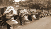 Ravana head effigies on the street sepia — Stock Photo
