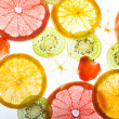 Stock Photo: Slices citrus on white background