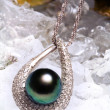 Jewelry with the black pearl and diamond - Stock Photo