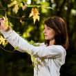 Stok fotoğraf: Autumn portrait of young pretty woman