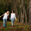 Autumn portrait of mother and daughter — Stock Photo #1319406