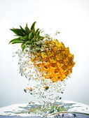 Pineapple splashing in water — Photo