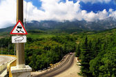 Mountain landscape - road, clouds and th — Stock Photo