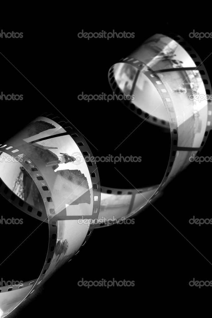 Closeup image of curling 35mm film. — Stock Photo #1312295