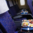 Boeing airplaine interior, meal - Stock Photo