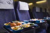 Boeing airplaine interior, meal — 图库照片