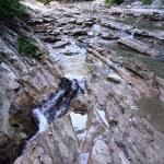 Small mountain river flows under bridge — Stock Photo #1296594
