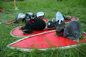 Knight armor lying on green grass — Stock Photo
