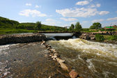 River with strong current flows under br — Stock Photo