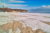 Empty sandy beach covered with snow — Stock Photo