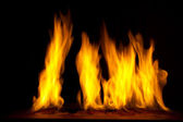 Fire on a dark background — Stock Photo