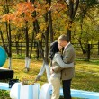 Couple in autumn park — Stock fotografie