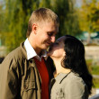 Young woman whispers to mans ear — Stock Photo #1296873