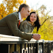 Young couple on bridge — Stock Photo