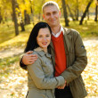 Man and woman in autumn park — Stock Photo