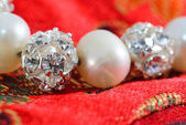 Pearl beads with crystal spheres — Stock Photo