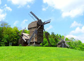 Landscape with watermill and blue sky — Stock Photo