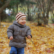 Happiness child playing in forest - Stock Photo