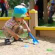 Little boy playing in sandbox — Stock Photo #1293437