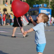 Little boy playing with air balloon — Stock Photo #1293487