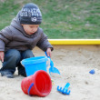 Little boy playing in sandbox — Stock Photo #1293508