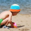 Little boy playing on beach — Stock Photo #1293514