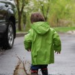 Small boy playing in puddles — Stock Photo
