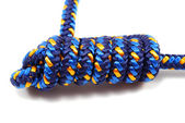 Climbing rope tied in a knot — Stock Photo