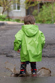 Baby playing in puddles — Stock Photo