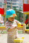 Little boy playing in sandbox — Stock Photo