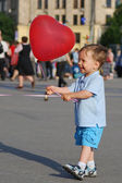 Little boy playing with air balloon — Stock Photo