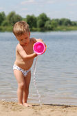 Little boy playing on the beach — Stock Photo