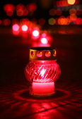 Burning votive candle — Stockfoto