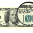 100 banknote through the magnifier — Stock Photo